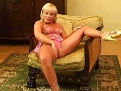 Blond MILF masturbates with sex-toy
