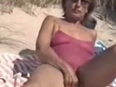Old woman concerning hirsute carry the jade filmed exposed in video instalment beyond the influence a rear beach.