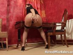 breasty ill-lit office hottie
