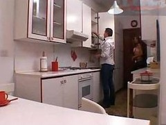 Lady-man sex in a kitchen