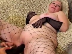 Grown up blond Cynthia sucks a wang and lets the man plaything her beefy fur pie