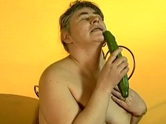 Sexually excited granny Julie groans thrash sing during the time that fucking the brush vag with a cucumber