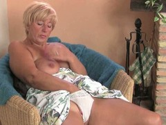 Large granny pleasures her cookie with a dildo